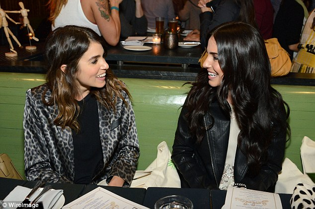 Girl talk: Nikki chatted to her pal former 90210 star Jessica Lowndes at the fashion event
