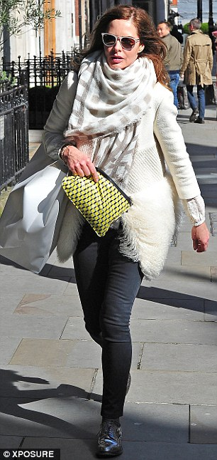 Quick dash: Trinny was seen running to the clothes store Celine before emerging with a large bag