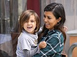 Her little angel: Kourtney Kardashian carried her adorable boy Mason during a family outing on Friday in Los Angeles