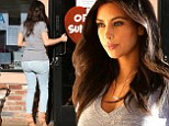 What weight gain? Kim Kardashian looks trim and toned in tight jeans and plunging T-shirt after complaining she has put on some unwanted pounds