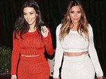 Kim Kardashian loves her $2,000 Calvin Klein pencil skirt and cropped top so much she buys the outfit in TWO different colours