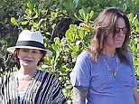 Happy holidays: Sharon and Ozzy Osbourne look a little down in the dumps as they holiday in Maui in Hawaii
