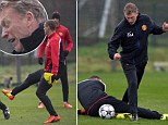 Manchester United's manager David Moyes avoids being hit by a ball