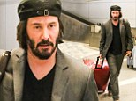 Keanu Reeves takes his mane undercover in a jaunty hat for airport run... after being spotted with a white patch on scalp