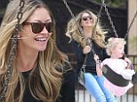 A whole new level! Rebecca Gayheart taps into her inner child and enjoys a Saturday with her young daughters playing on a swing set