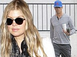 Honey I'm home! Fergie arrives back in Los Angeles following trip to Washington D.C.  as Josh Duhamel bides his time draining liquid from knee