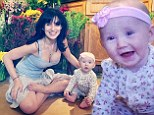 Yogi Hilaria Baldwin showcases cleavage...and the lotus position alongside adorable daughter Carmen