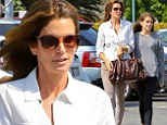 Double trouble! Cindy Crawford stays in step with her lookalike daughter Kaia Gerber as they don mismatching outfits