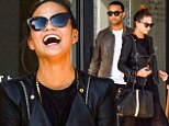 Leather lovers! Chrissy Teigen and John Legend wear matching jackets as model flashes her legs in sheer skirt