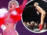 Showering her audience! Miley Cyrus spits water onto her fans during concert ... to huge cheers