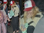 Giggly: Sienna Miller dissolves into laughter as she leaves London's Groucho Club