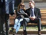 Romance: Carla Bruni and Former French President Nicolas cuddle on a  park bench after they vote in local elections in Paris
