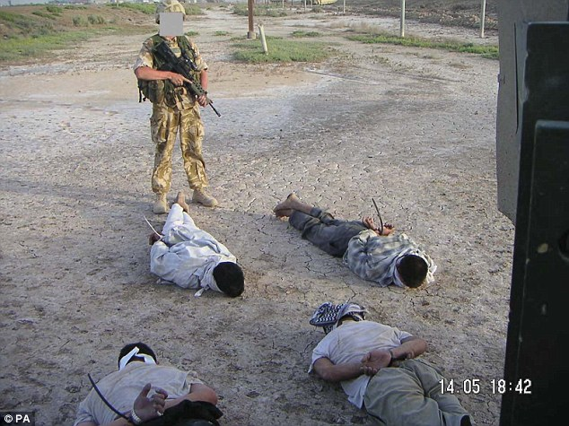 Probe: Allegations that soldiers had executed Iraqi captives were unfounded. The above photograph, shown during the inquiry, shows a soldier guardian prisoners