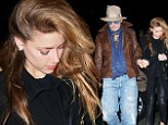 They're inseparable! Johnny Depp grips fiancee Amber Heard's hand as they hit NYC together