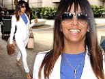 White hot! Eva Longoria shows off svelte physique and taut derriere in a stylish white ensemble