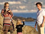 Kate Hudson and Matt Bellamy on 'the rocks'... as they put split rumours behind them with family day at the beach