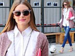 Olivia Palermo looks stylish as she walks her dog, Mr Butler, out and about in New York