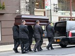 Solemn: The casket reportedly carrying the body of L'Wren Scott was moved from a New York City funeral home on Sunday morning to Los Angeles