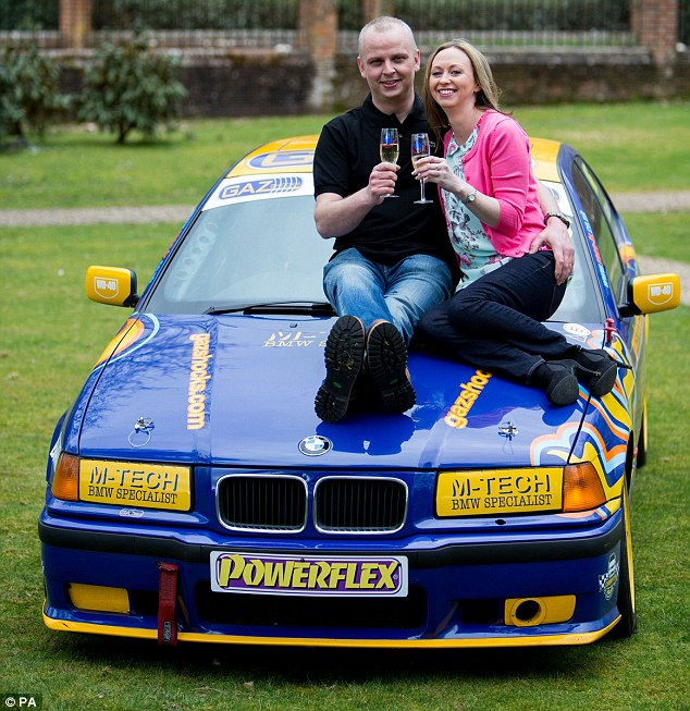 Victorious: Car mechanic Neil Trotter, with partner Nicky Ottaway, celebrates his win in Dorking, Surrey, where he was revealed as the man who scooped a £108million jackpot on the Euromillions lottery
