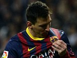 Club legend: Lionel Messi lifts his shirt to kiss the Barcelona badge after scoring the decisive El Clasico penalty