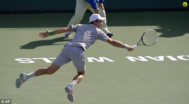 Winner: Djokovic (pictured) made hard work of a win against John Isner on Saturday