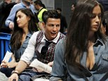 Irina and Cristiano watch the basketball in Madrid