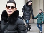 Retail therapy: Julianna Margulies stepped out for a spot of shopping with her six-year-old son Kieran shortly before the surprising Good Wife scenes aired in the US