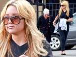 What a Girl Wants... is her family! Amanda Bynes looks healthy as she gives her grandma a helping hand across the road