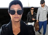 That's not like you! Kourtney Kardashian and Scott Disick go for very casual looks as they dash to LAX