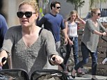 She's All That: Anna Paquin is supermum as she pushes twins Charlie and Poppy so fast husband Stephen Moyer struggles to keep up