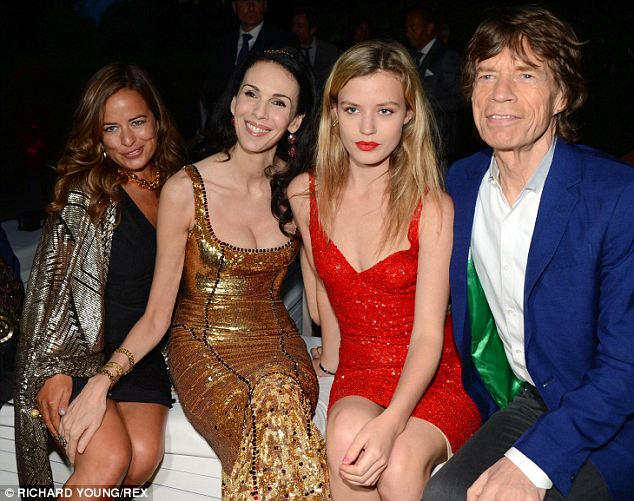 Family: L'Wren (center left) had become close with Jagger's daughters from previous relationships, including Jade (left) and Georgia May (center right) whose mothers are his first and second wives respectively