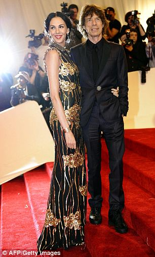 Glamor couple: Scott was a well-known designer in her own right but had become a more famous name since she took her relationship with Jagger public (seen together at the Met Costume ball in 2012 at left and in 2011 at right)