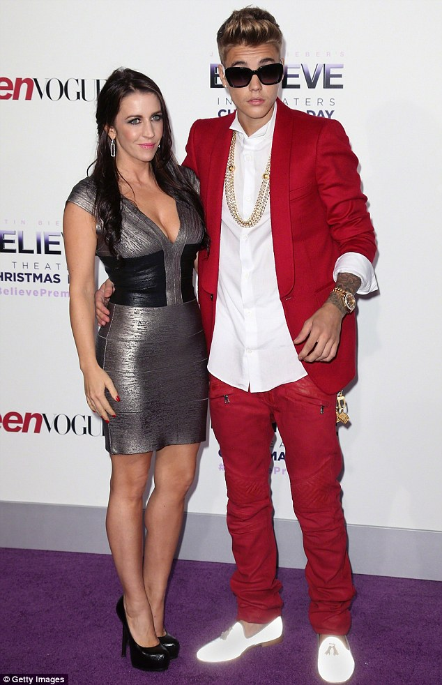 Thanks, mum! Justin is said to be paying $8,000 to his mother Pattie Mallette - pictured here on December 13, 2013 at a film premiere - to live in her Los Angeles home