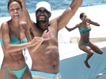 Nicole Murphy, 46, reveals her impressive bikini body while jumping off a yacht in St. Barts with shirtless Michael Strahan