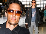 Mahola, dude! Matthew McConaughey shows off his American pride while departing from LAX in a scruffy and inconspicuous outfit