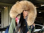 She looks... normal! Rihanna wears fur-lined parka and jeans upon arrival at Heathrow airport