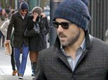 Cute couple: Ryan Reynolds wrapped a protective arm around his wife Blake Lively as she took a break from filming her latest movie, The Age of Adaline, to grab a spot of lunch in Vancouver, Canada, on Sunday afternoon