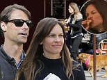 She can't leave home without them! Hilary Swank strolls through Paris with boyfriend Laurent Fleury and dogs... and stuffs her face at Parisian cafe