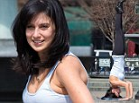 Taking yoga to a whole new level: Hilaria Baldwin maintains complex headstand while posing on a stone in Bleecker Street
