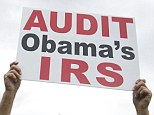 """Demonstrators with the Tea Party protest the Internal Revenue Service (IRS) targeting of the Tea Party and similar groups during a rally called """"Audit the IRS"""" outside the US Capitol in Washington, DC, June 19, 2013. AFP PHOTO / Saul LOEB        (Photo credit should read SAUL LOEB/AFP/Getty Images)"""
