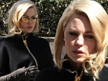 Super glam! New mother Melissa George wears elegant black cape on set... and hides those tired eyes behind chic golden glasses