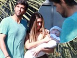 Doting Dad: New father Mark Philippoussis carries young son cradled in his arms en route to church ceremony