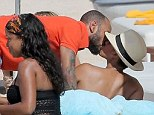 Awkward: Alicia Keys is seen enjoying the amorous attentions of her husband Swizz Beatz as they holiday with is ex-wife Mashonda Tifrere at the Nikki Beach Resort in St Barts