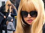 All for Skyler! Rachel Zoe rugs up in all black and thigh-high boots as she continues celebrating her son's birthday in NYC