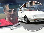 Showing off his hot rod! David Arquette goes for a spin in his classic sports car in Los Angeles