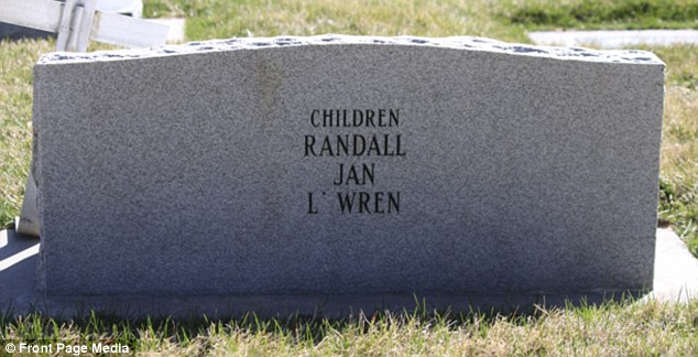 Memorial: L'Wren's name etched on the headstone of her parents