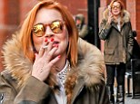 Destressing? Lindsay Lohan was seen smoking outside of The Mercer Kitchen in New York's Soho neighbourhood on Monday