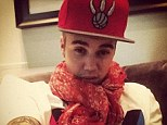 "'Love it when we're ""lovey dovey""': Justin Bieber shares a selfie donning red cap and scarf, possibly sending a message to on/off girlfriend Selena Gomez"