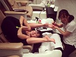 She nailed it! Hilaria Baldwin goes head over heels in latest yoga pose while getting a pedicure