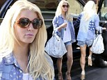 She did it! Jessica Simpson slips back into her Daisy Dukes and shows off slender legs after amazing weight loss